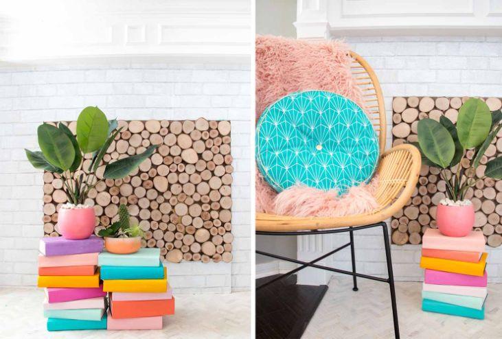 plante verzi in ghivece colorate, carti in multe culori, fundal deschis cu felii de lemn